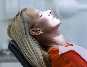 Relaxing woman in dental chair