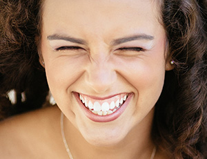 Laughing woman with flawless smile