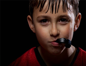 Boy wearing mouthguard