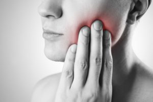 A woman with tooth pain.