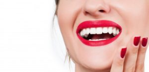 woman smiling with red lip stick