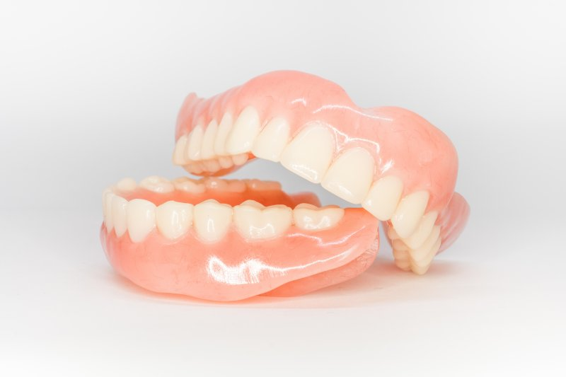 an up-close look at a top and bottom denture